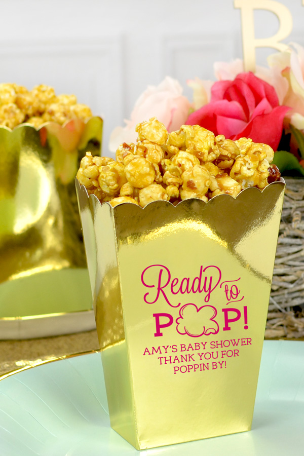 Ideal for favors table or to be placed at each place setting, Gold mini popcorn boxes printed with  Hot Pink imprint, BS128 - Ready to Pop design, and three lines of print in Eligible lettering style