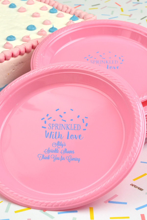 Ideal for cake, cookies, and desserts at your baby shower, 7 inch New Pink plates with Light Blue imprint, BS126 - Sprinkled with Love design, and three lines of print in Lovable lettering style