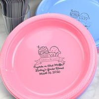 Perfect for the buffet at your baby shower, new pink and pastel blue dinner plates with dark gray imprint, BS115 - Bun in the Oven design, and three lines of print in Precious lettering style