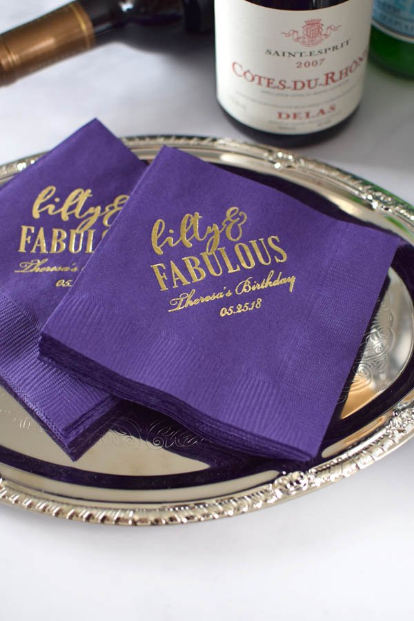 Purple napkins printed with Gold imprint, ABT104 design, and two lines of text in Stylish lettering