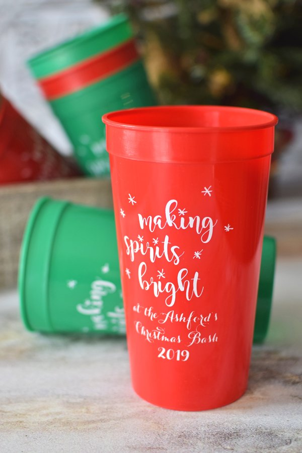 Red and green 32 oz stadium cups printed with White imprint color, CS1113 design, and Perky lettering style