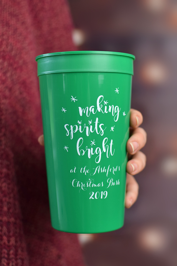 Green 32 oz stadium cups printed with White imprint color, CS1113 design, and Perky lettering style