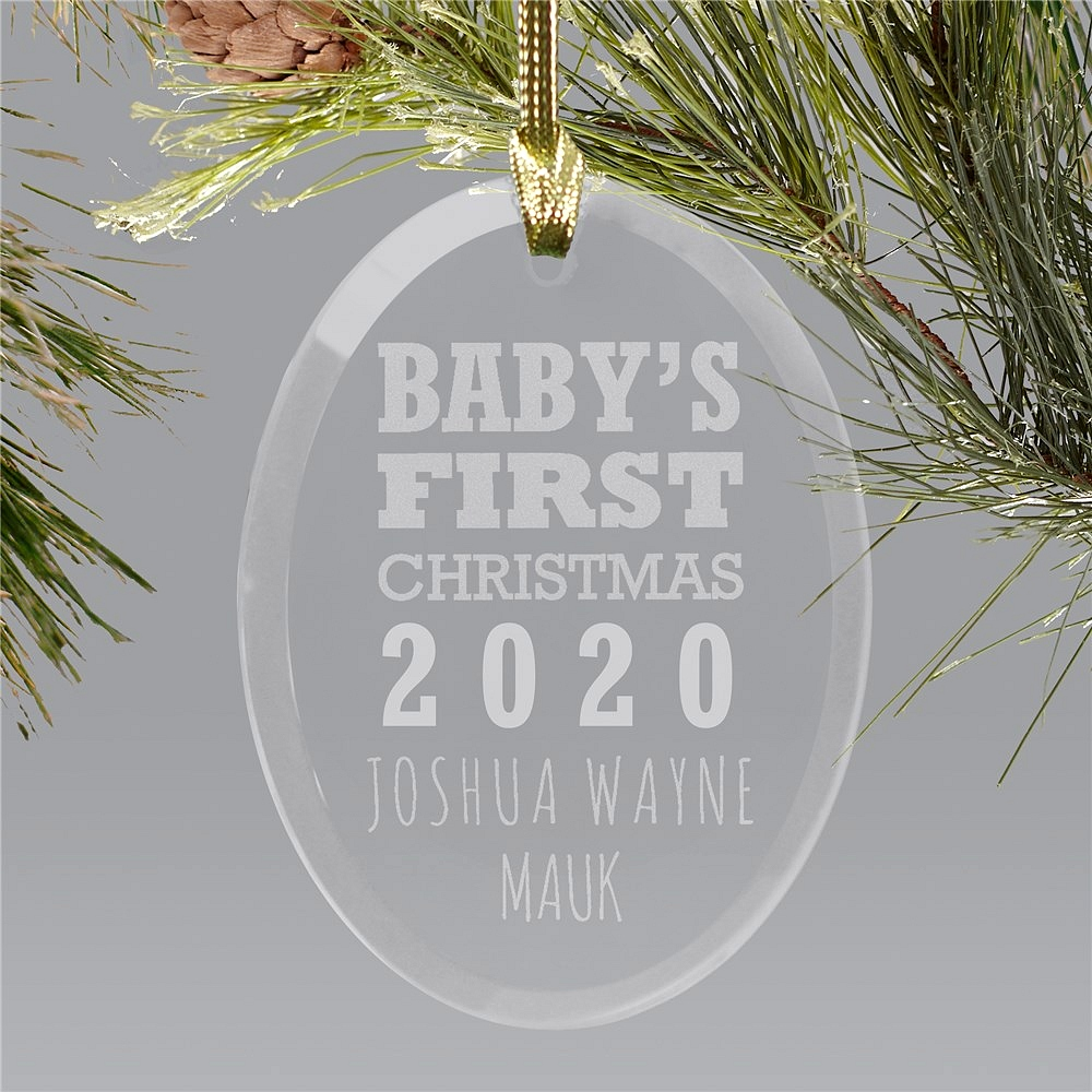 Baby's First Christmas oval glass ornament personalized with baby birth year and two lines of custom print for baby's name