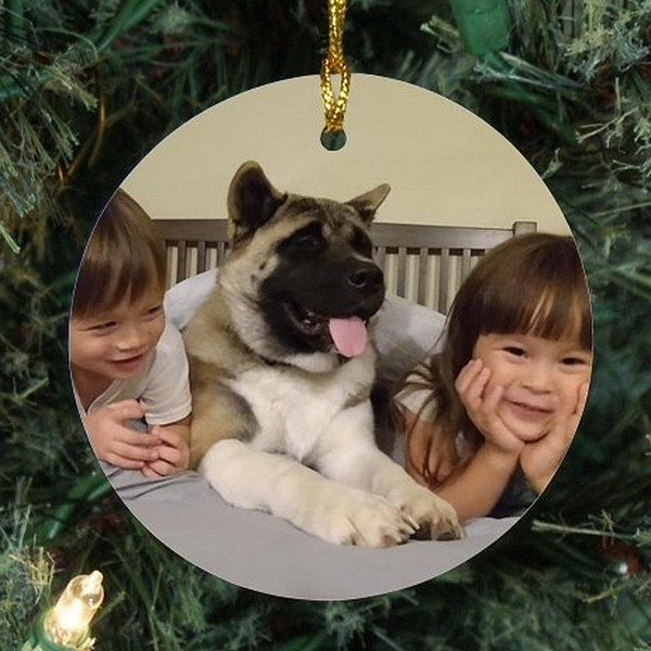 Round ceramic Christmas tree ornament for pets personalized with happy dog and kids