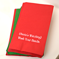 Red and Green hand towels printed with White imprint and two lines of text in Poised lettering style