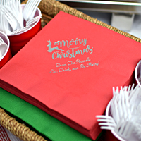 Red and green dinner napkins printed with Silver imprint, CS1111 design, and Blissful lettering style