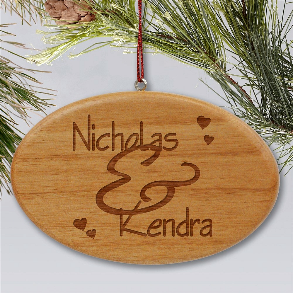 Oval shape wooden Christmas ornament personalized with couple's names