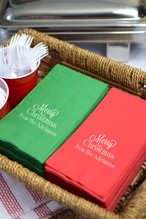 Red and green napkins printed with White Imprint, CS1109 design, and Poised lettering style