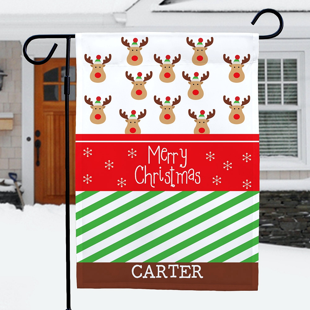 `Festive reindeer and christmas wrapping paper design Christmas garden flag personalized with custom name
