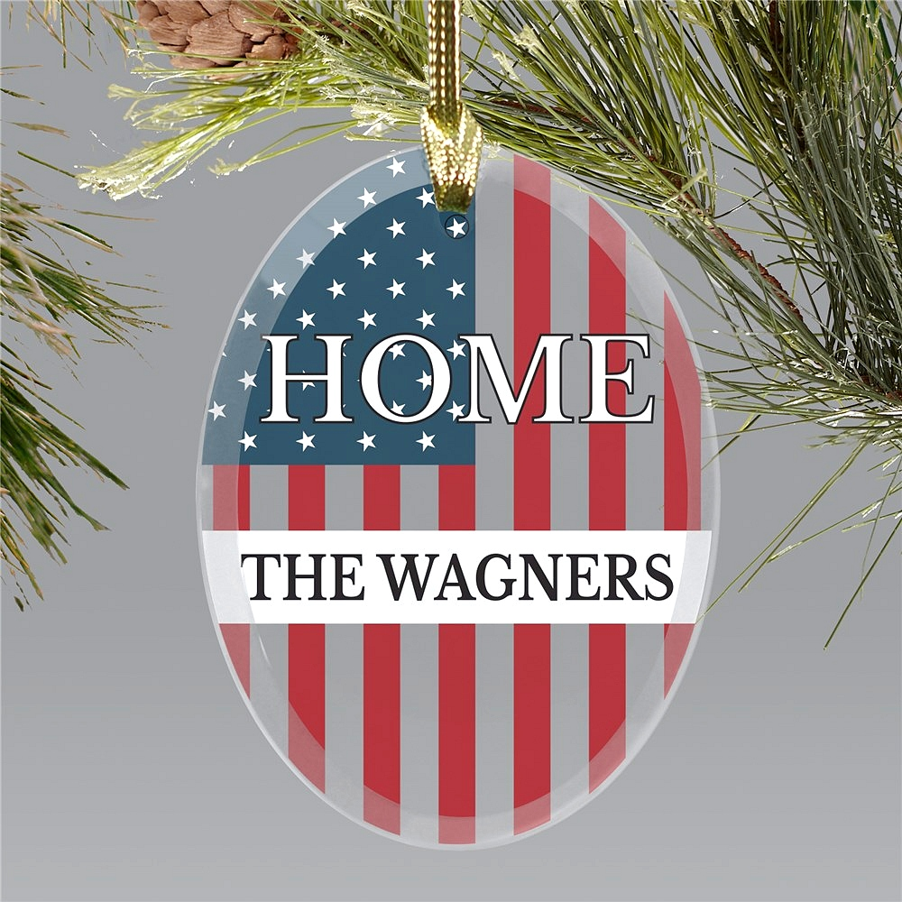 Patriotic oval glass ornament displaying word HOME over U.S. flag personalized with family name