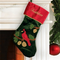 Red cardinal on green and red velvet Christmas stocking personalized with name