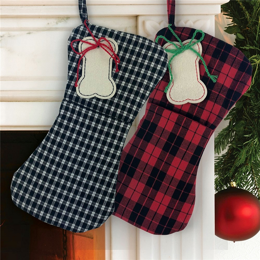 Bone shaped Christmas stocking for dogs available in black plaid or red plaid