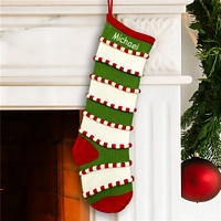 Green and white stripe knit Christmas stocking personalized with embroidered name