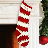 Red and white stripe candy cane theme knit Christmas stocking personalized with embroidered name