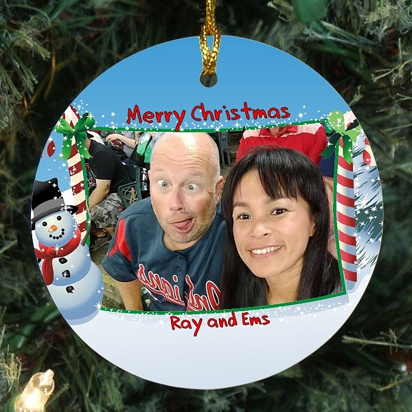 Holiday snowman tree ornament personalized with picture of couple with Merry Christmas message and names