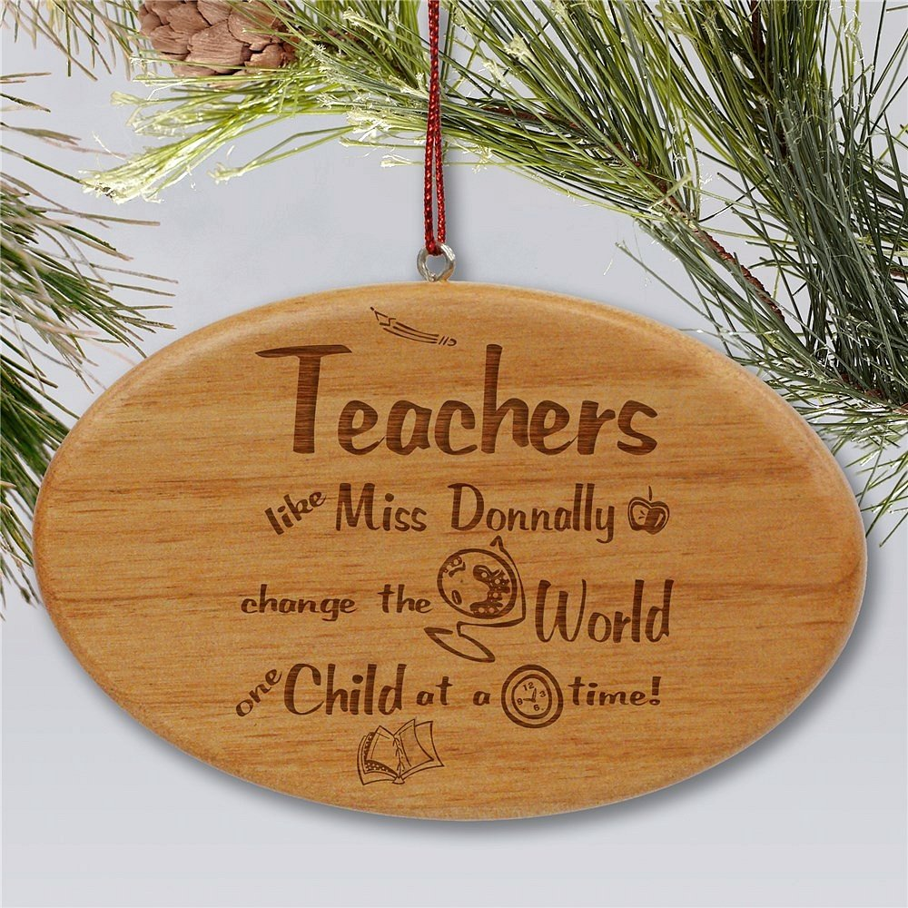 Oval shape wooden Christmas ornament personalized with 'Teachers change the world, one child at a time' message, teacher's name and school theme graphics