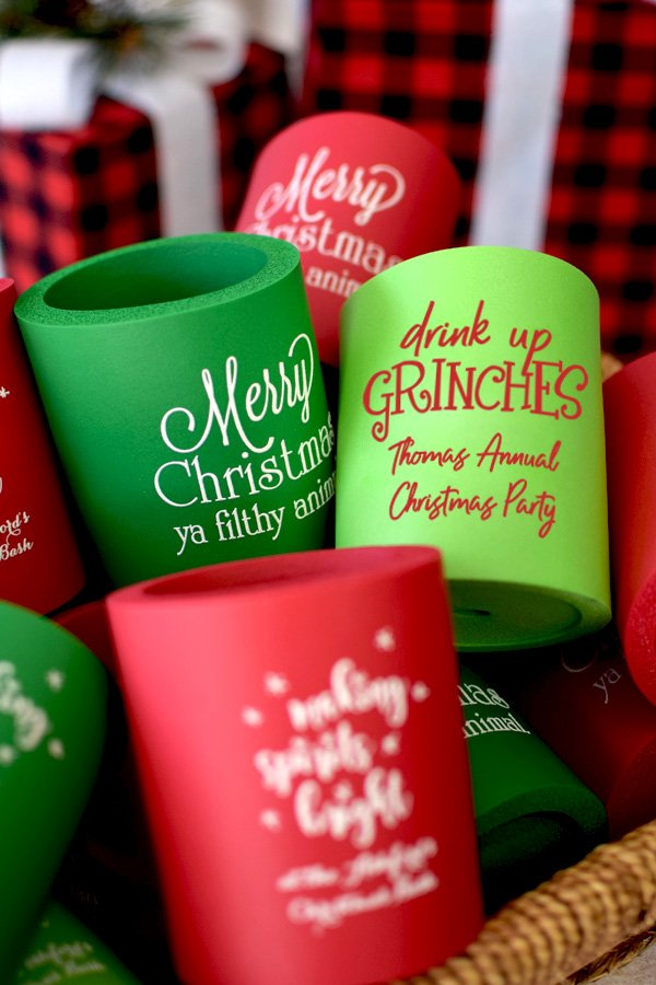 Red, Green, and Neon green koozies printed with CS1109 design, White imprint, and one line of text in Poised lettering style