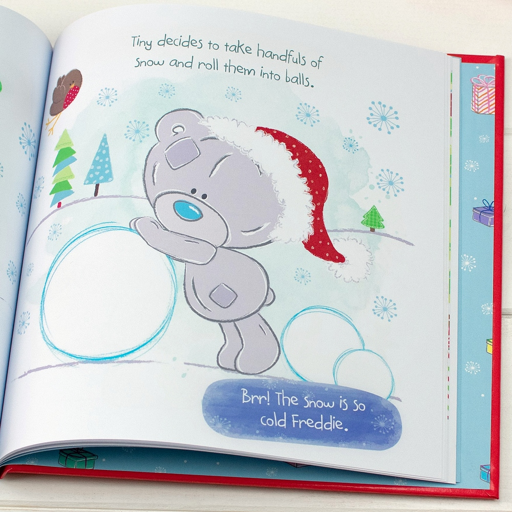 Tiny Tattty Teddy making a large snowball in Tiny Tatty Teddys Christmas personalized kids book