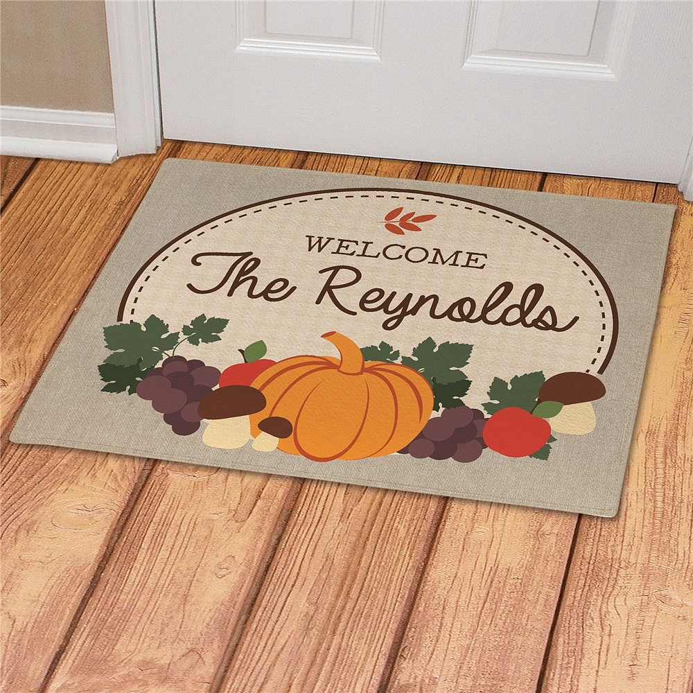 Autumn welcome door mat featuring fall fruits personalized with welcome message and family name