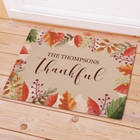 Colorful fall leaves border doormat personalized with 'Thankful' message and family name