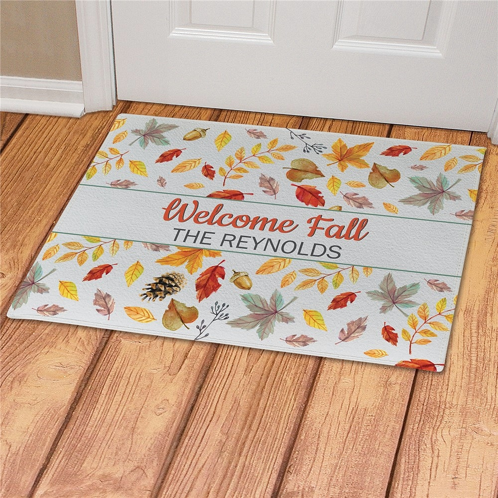 Colorful fall leaves doormat personalized with Welcome Fall message and family name