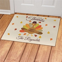 Whimsical Thanksgiving turkey design on Give Thanks doormat personalized with family name