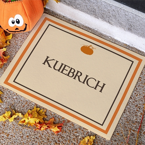 Fall doormat with pumpkin design and pumpkin orange border personalized with family name