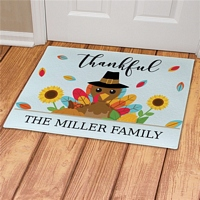 Colorful thankful turkey welcome mat personalized with family name