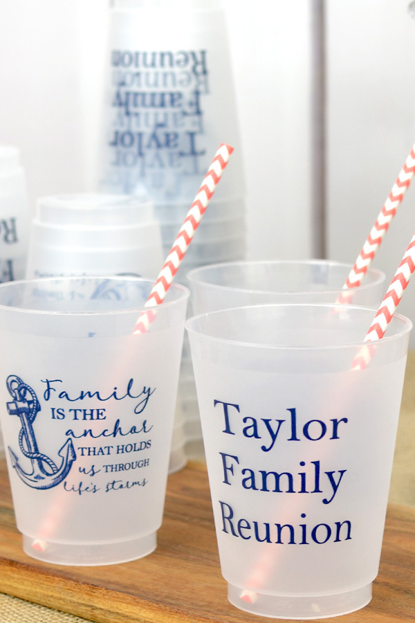 Personalized 16 ounce frosted plastic cups with Navy imprint, three lines of text on the front and a design on the back