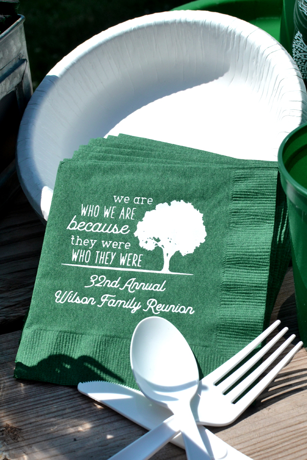 Custom printed family reunion beverage napkins in forest green with white imprint of the FR117 design with 2 lines of custom print in Garris lettering style