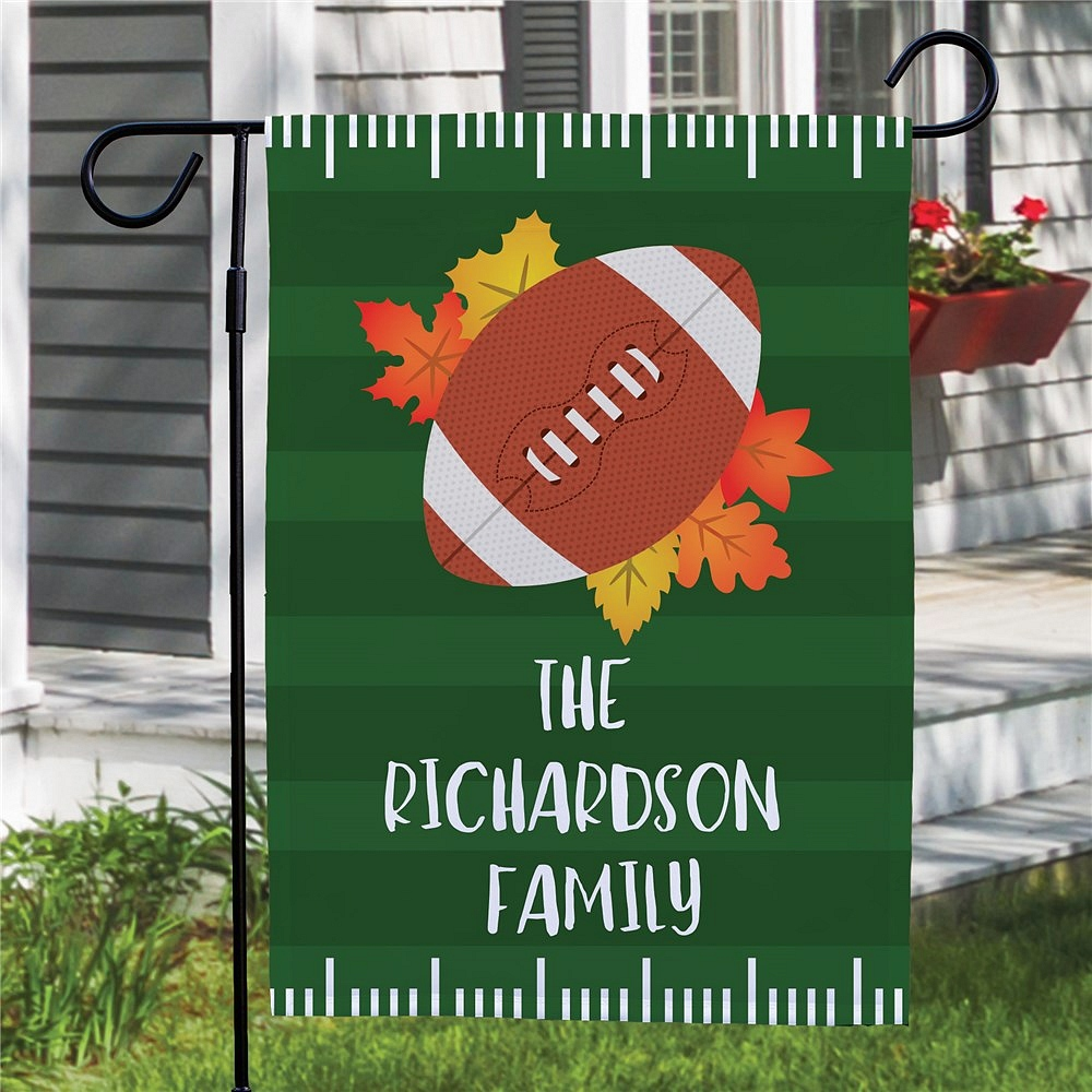 Fall Leaves Football garden flag personalized with family name over green football field background
