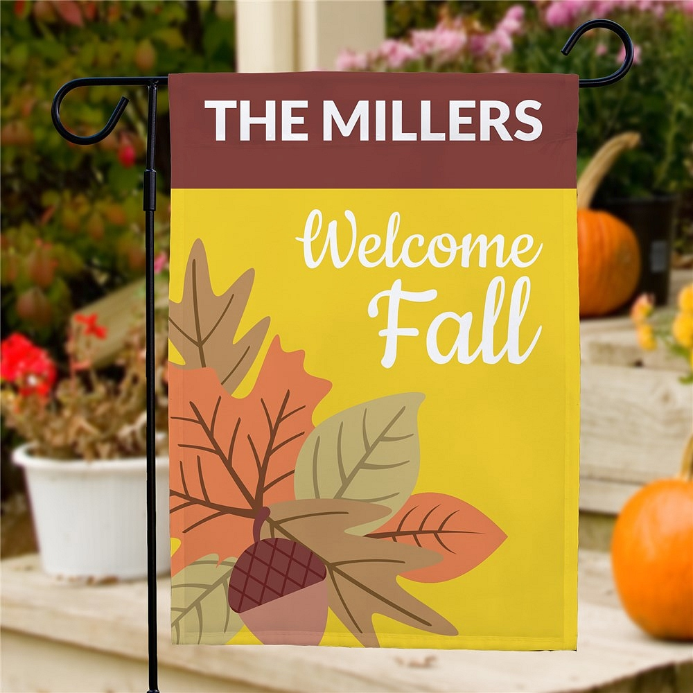 Welcome Fall garden flag featuring big and bold leaves on yellow background personalized with family name and Welcome Fall message
