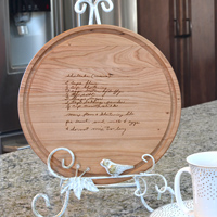 10 Inch Round Cutting Board shown in Cherry Wood