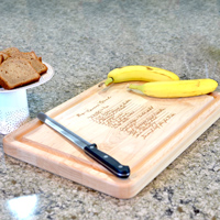 18 x 12 Inch Maple Cutting Board featuring a laser-engraved family recipe.
