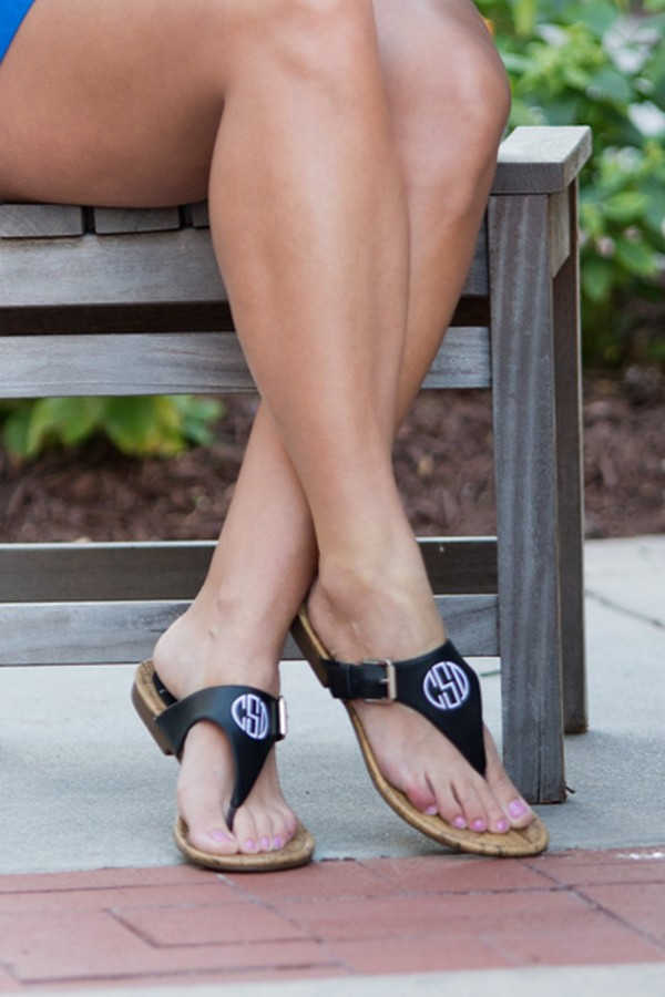 Woman wearing her black faux leather everyday sandals