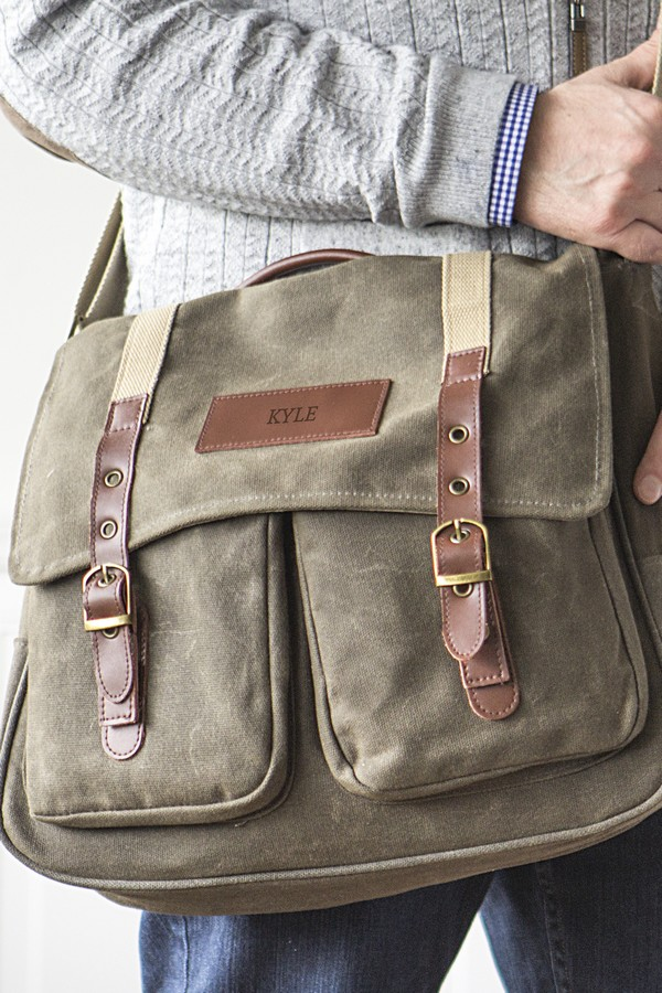 4db4ef269dc Man holding his personalized men s wet waxed canvas messenger bag