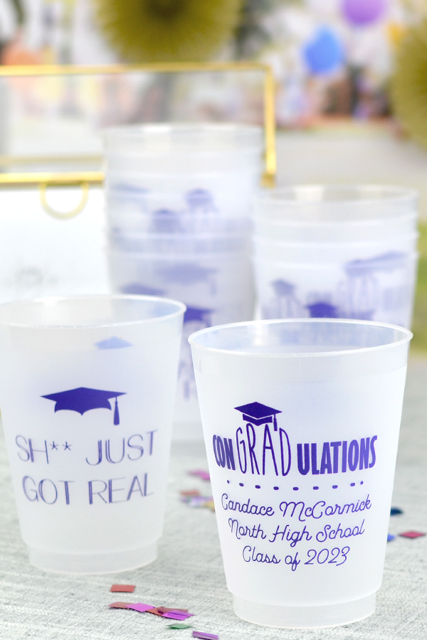 16 oz frosted favor cup printed with Purple imprint color, G1215 and G1225 designs, and 3 lines of custom text in Garris lettering style