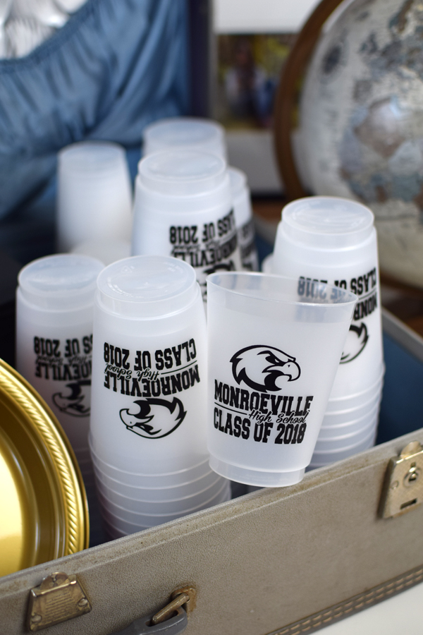 Frosted plastic cups printed with ML-04 mascot layout and black imprint