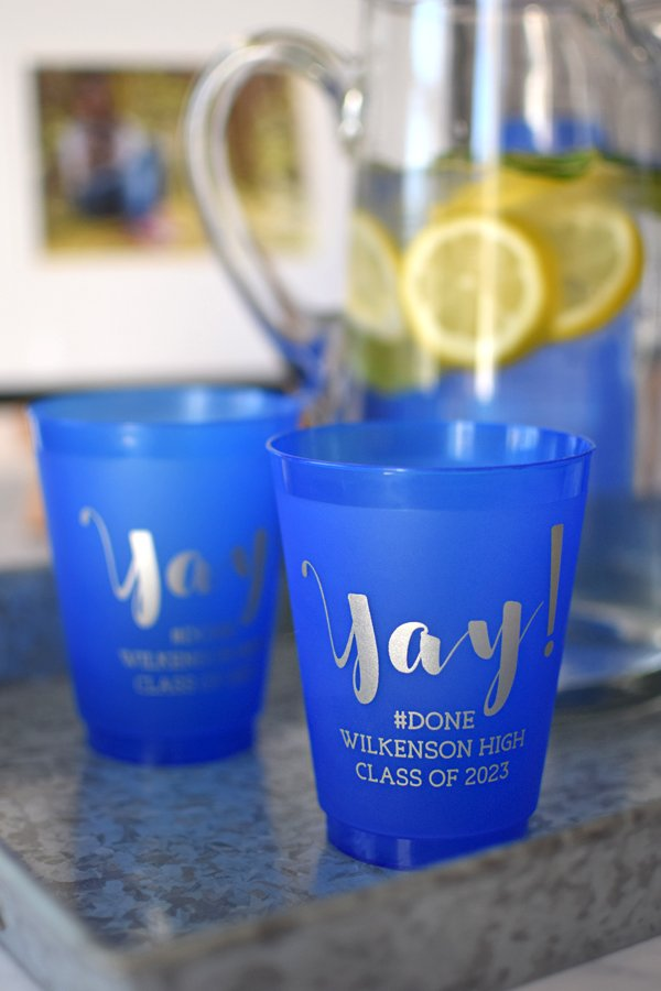 Blue frosted cups printed with Silver imprint, G1214 design, and Eligible lettering style