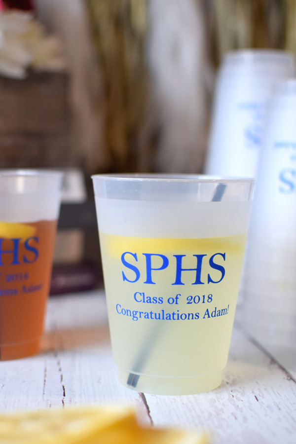 Frosted graduation cups printed with Royal Blue imprint and three lines of text in Strong lettering style with request to print Line 1 larger