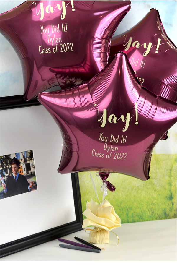 Personalized Berry Mylar Star Balloon with design G1214 and 3 lines of text printed in Ivory Imprint Color and Quick Lettering Style.
