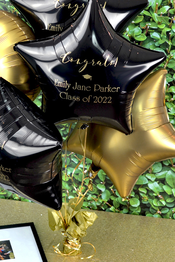 Personalized Black Mylar Star Balloon with design G1210 in Gold Imprint and Poised Lettering Style.