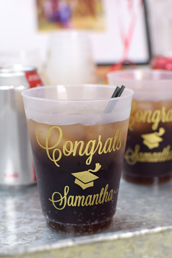 16 oz frosted cups printed with Gold imprint color, G1211 design, and Lovable lettering style
