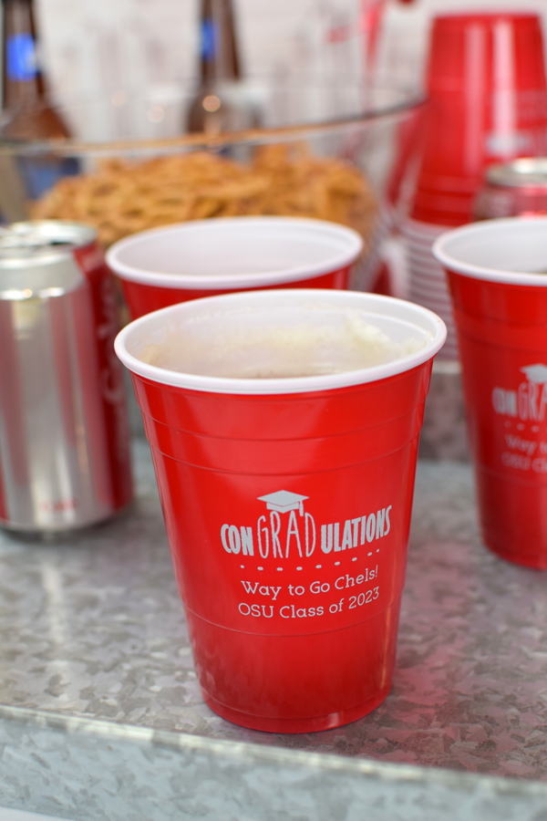 Perfect for an outdoor party, BBQ, or backyard bash, decorate and celebrate with disposable, custom printed graduation party solo cups.