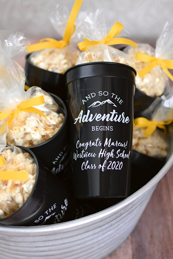 And So The Adventure Begin. These custom printed, jumbo 32 oz graduation stadium cups are the Big Gulps of party cups. Great for outdoor graduation parties and for holding popcorn and iced tea. An extra large cup for a larger than life celebration.