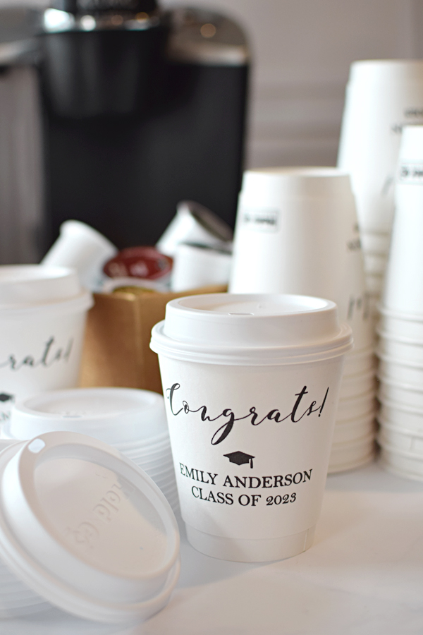 Display personalized 12 ounce paper Graduation to-go cups at your coffee station which feature a built-in cup sleeve to keep your hands comfortable and your beverage hot.