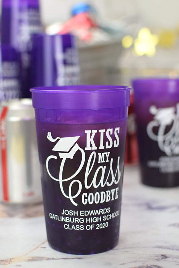 Kiss My Class Goodbye. A great size for outdoor parties and for serving iced drinks, celebrate your milestone graduation party with custom printed, reusable 22 oz plastic stadium cups. Personalized with a fun grad design and custom message.