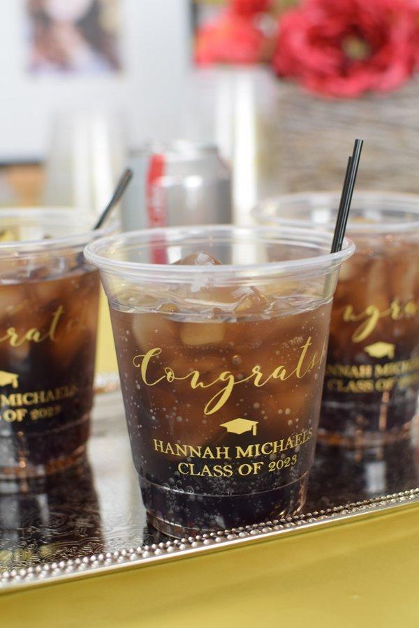 12 oz graduation party solo cups are so versatile - perfect for serving soda pop, iced tea, punch, and more at your graduation party.  Each custom printed cup is personalized with a graduation design and custom message.  Made from disposable plastic, making clean up a breeze.