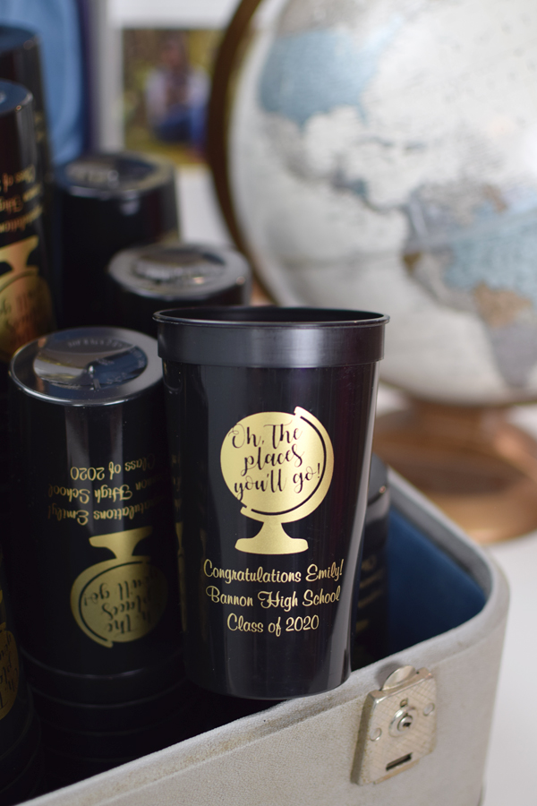 Black stadium cups printed with Gold imprint, G1205 design, and Fabulous lettering style