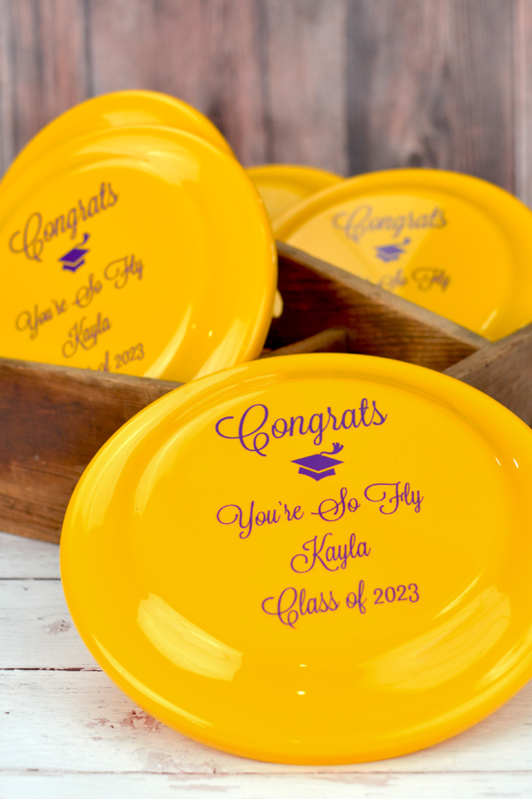 Family Reunion party custom printed disc golf flying discs in Yellow with design and custom text in Purple imprint